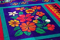 Antigua, Guatemala.  Holy Week, Semana Santa.  Detail of the alfombra (carpet) of colored sawdust decorating the main aisle of the Church of San Francisco.