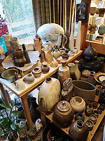BNPS.co.uk (01202 558833)<br /> Pic: AdamPartridgeAuctioneers/BNPS<br /> <br /> Pictured: The Dining was of course filled with pots<br /> <br /> A huge collection of pottery and ceramics found stacked inside the suburban home of an elderly couple has sold for almost £200,000.<br /> <br /> Leonard and Alison Shurz filled every room of their three bed house with ceramic pieces they had gathered from all over the world.<br /> <br /> The Aladdin's Cave of pots, bowls, plates, vases and jugs was found by a stunned auctioneer who had the daunting task of cataloguing it all.