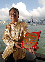 Edwin Ma a hong kong Fengshui master and astrologer poses outside the Tau Ma Tei Temple, Hong Kong.  Mr Ma is one of Hong Kong's best know Feng Shui masters and often appears in newspapers and on TV, he analysed the Fengshui of Tony Chan, who recently inherited billions from the late Nina Wang.