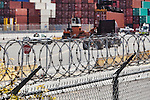 Razor Wire and Fencing surrounds container terminal in Seattle, Washington. This image available for license through exclusive agency.  Please contact the photographer