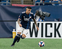 FOXBOROUGH, MA - JULY 18: Gustavo Bao #7 dribbles during a game between Vancouver Whitecaps and New England Revolution at Gillette Stadium on July 18, 2019 in Foxborough, Massachusetts.