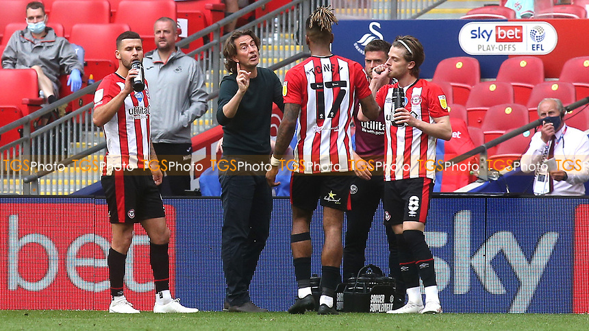 Brentford Manager, Thomas Frank has a quick word with Ivan Toney on the touchline while there is a break in play during Brentford vs Swansea City, Sky Bet EFL Championship Play-Off Final Football at Wembley Stadium on 29th May 2021