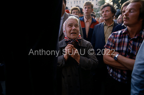 Moscow, Soviet Union<br /> August 25, 1991<br /> <br /> Fearing reprisals for demonstrating in front of the KGB building at Lubyanka Square just days after a failed coup d'état (August 19-21, 1991), also known as the August Putsch or August Coup. A small group of the Soviet government officials briefly deposed president Mikhail Gorbachev in an attempted to take control of the country. The coup leaders were hard-line members of the Communist Party (CPSU) who felt that Gorbachev's reforms had gone too far in dispersing the central government's power to the republics - better known as perestroika. The coup collapsed in three days, and Gorbachev returned to power, crushing the Soviet leader's hopes that the union could be held together in a decentralized form.