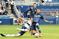 KANSAS CITY, KS - MAY 16: Khiry Shelton #11 Sporting KC shoots on goal during a game between Vancouver Whitecaps and Sporting Kansas City at Children's Mercy Park on May 16, 2021 in Kansas City, Kansas.