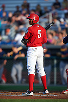Auburn Doubledays third baseman Kelvin Gutierrez (5) at bat during a game against the State College Spikes on July 6, 2015 at Falcon Park in Auburn, New York.  State College defeated Auburn 9-7.  (Mike Janes/Four Seam Images)