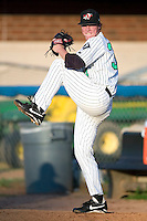 Winston-Salem's Lucas Harrell warms up in the bullpen prior to taking on the Frederick Keys at Ernie Shore Field in Winston-Salem, NC, Thursday, June 15, 2006.  Winston-Salem defeated Frederick 1-0 in game 1 of a double-header.