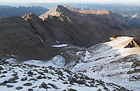 The northeast ridge route climbs up the valley in the center of the photo almost to the cirque, and then up the mountainside to the right of the image.  Conundrum Peak (14,064 feet) is on the left side of this image, with its distinctive couloir still filled with last winter's snow.