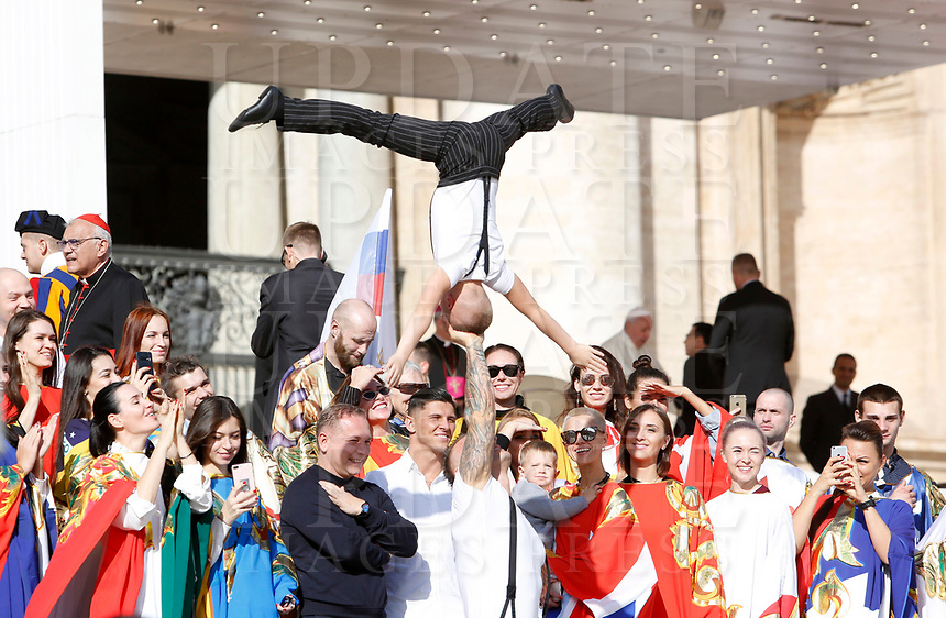 Circus artists perform at the end of the weekly general audience held by Pope Francis, seen in background at right, in St. Peter's Square at the Vatican City, October 16, 2019. UPDATE IMAGES PRESS/Riccardo De Luca<br /> <br /> STRICTLY ONLY FOR EDITORIAL USE