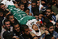 Palestinian mourners carry the body of one of 6 Hamas militants were killed by an Israeli air strike, during their funeral in Buraije refugee camp, Centeral Gaza Strip, Tuesday, Aug. 21, 2007. (FADY ADWAN)
