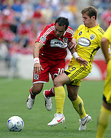 Columbus Crew midfielder Robbie Rogers (19) upends Chicago Fire midfielder Cuauhtemoc Blanco (10).  The Columbus Crew tied the Chicago Fire 2-2 at Toyota Park in Bridgeview, IL on September 20, 2009.