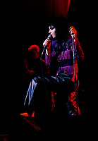Montreal (Qc) CANADA - File Photo - Circa 1986 -<br /> Siouxie and the Banshees in concert,<br /> <br /> Siouxsie & the Banshees were a British rock band that formed in 1976. Led by the singer Siouxsie Sioux and the bassist Steven Severin, the band's only constant members, the Banshees formed at the advent of the British punk scene and soon became one of the major bands in the post-punk. Their music influenced a wide range of very diverse bands over the years . The group released a total of eleven studio albums from 1978 to 1995.<br /> <br /> -Photo (c)  Images Distribution