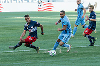 FOXBOROUGH, MA - SEPTEMBER 19: Brandon Bye #15 of New England Revolution and Alexander Callens #6 of New York City FC compete for the ball during a game between New York City FC and New England Revolution at Gillette on September 19, 2020 in Foxborough, Massachusetts.