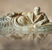 Close up of an Etruscan Hellenistic style cinerary, funreary, urn cover with a man,  National Archaeological Museum Florence, Italy