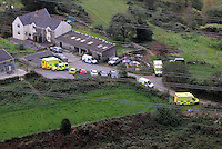 Pictured: Aerial view showing ambulances on stand by at a farm near Gleision Colliery. Friday 16 September 2011<br /> Re: It has been announced that the dead body of one of the miners has been found by emergency services trying to rescue four colliers that have been trapped at Tareni Gleision drift colliery at Cilybebyll, near Pontardawe, south Wales.<br /> The four men who are subject of the rescue operation have been named as Phillip Hill, aged 45, from Neath, Charles Bresnan, aged 62, from the Swansea Valley, David Powell, aged 50, from the Swansea Valley, and Garry Jenkins, aged 39, from the Swansea Valley.