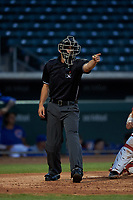 Home plate umpire Sean Sparling asks for help on a check swing during an Arizona League game between the AZL Angels and AZL Cubs 1 on June 24, 2019 at Sloan Park in Mesa, Arizona. AZL Cubs 1 defeated the AZL Angels 12-0. (Zachary Lucy / Four Seam Images)