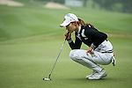 Min Sun Kim of South Korea ponders her next move on the green during Round 4 of the World Ladies Championship 2016 on 13 March 2016 at Mission Hills Olazabal Golf Course in Dongguan, China. Photo by Victor Fraile / Power Sport Images
