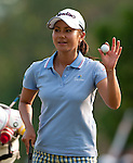 CHON BURI, THAILAND - FEBRUARY 16:  Ai Miyazato waves to the crowd after a putt on the 18th hole during day one of the LPGA Thailand at Siam Country Club on February 16, 2012 in Chon Buri, Thailand.  Photo by Victor Fraile / The Power of Sport Images