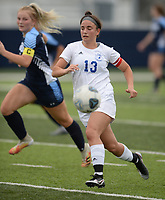 Rogers' Jourdan Badely (13) dribbles the ball up the field Tuesday, April 27, 2021, ahead of Springdale Har-Ber's Natalie Bartlett during the first half of play at Wildcat Stadium in Springdale. Visit nwaonline.com/210428Daily/ for today's photo gallery. <br /> (NWA Democrat-Gazette/Andy Shupe)