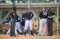 FCL Tigers East manager Gary Cathcart (25) during the lineup exchange with Tyson Blaser (50), umpires Omar Alvarado and Nelson Fraley, before a game against the FCL Yankees on June 28, 2021 at Tigertown in Lakeland, Florida.  (Mike Janes/Four Seam Images)