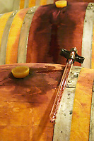 Cave P et Andre Perret in Chavannay, making Condrieu, Saint Joseph, Cote Rotie.  In the winery. On top of a barrique a pipette for taking samples.   Andre André P et A Perret, Chavanay, Rhone, France, Europe
