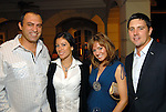 From left: Kiki and Carmen Dikmen with Gina and Jarrad Coulter at the Second Annual True Blue Gala sponsored by the Houston Police Foundation at the home of Paige and Tilman Fertitta Saturday Oct. 17,2009. (Dave Rossman/For the Chronicle)