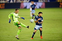 CARSON, CA - OCTOBER 18: Evan Bush #30 GK almost nails teammate Erik Godoy #22 of the Vancouver Whitecaps moves to the ball while clearing a ball during a game between Vancouver Whitecaps and Los Angeles Galaxy at Dignity Heath Sports Park on October 18, 2020 in Carson, California.
