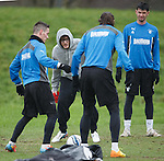 James Arthur X Factor winner can't get the ball from Ian Black and Bilel Mohsni as he tries to compete with the Rangers players at training
