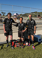 The match officials pose for a photo at halftime in the New Zealand Age Group Championships 1998/99 Federation Boys match between Auckland (white tops) and Mainland (red tops) at Alex Moore Artificial Turf, Petone, Wellington, New Zealand on Tuesday, 16 December 2014. Photo: Dave Lintott / lintottphoto.co.nz