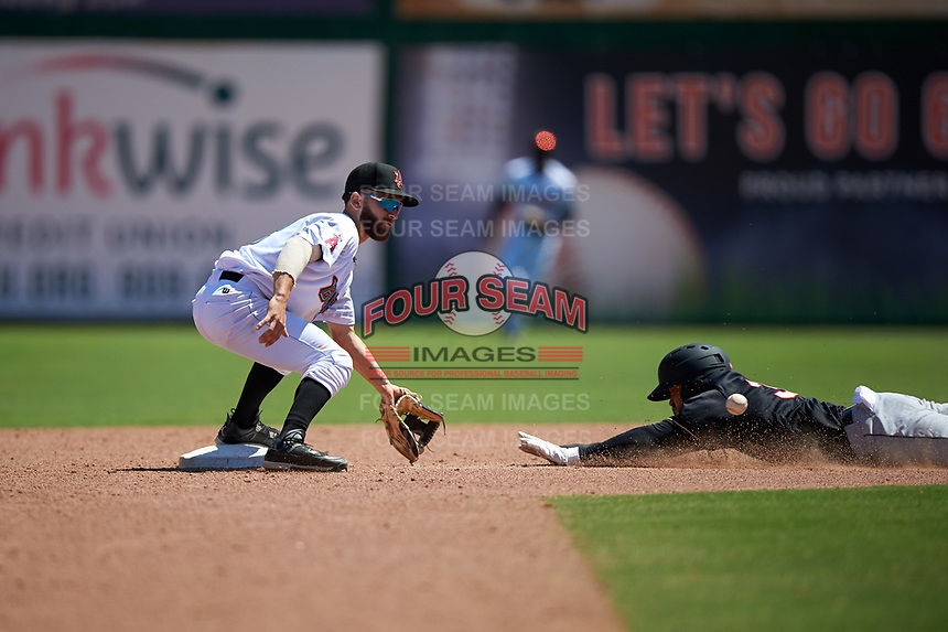 Inland Empire 66ers second baseman Alvaro Rubalcaba (12) covers the base on a steal attempt by Luis Liberato (34) during a California League game against the Modesto Nuts on April 10, 2019 at San Manuel Stadium in San Bernardino, California. Inland Empire defeated Modesto 5-4 in 13 innings. (Zachary Lucy/Four Seam Images)