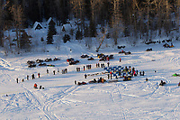 Teams stop in at the Yenta checkpoint on the Yentna river with Mt. Mckinely and the Alaska Range in the background a few hours after leaving the re-start line in Willow during the 2011 Iditarod.