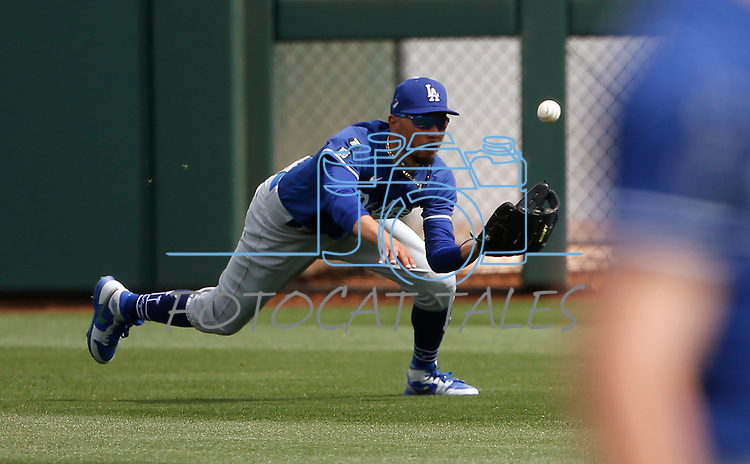 Mookie Betts makes a play during a spring training game between the Texas Rangers and Los Angeles Dodgers in Surprise, Ariz., on Sunday, March 7, 2021.<br /> Photo by Cathleen Allison