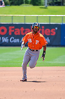 L.J. Hoes (28) of the Fresno Grizzlies hustles towards third base against the Salt Lake Bees at Smith's Ballpark on June 14, 2015 in Salt Lake City, Utah.  (Stephen Smith/Four Seam Images)