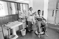 - Venezuela, La Guaira, barbershop in a popular neighborhood (ranchito), 1987<br /> <br /> - Venezuela, La Guaira, bottega di barbiere in un quartiere popolare (ranchito), 1987