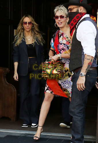 NEW YORK, NY- May 06: Miley Cyrus, with mother Tish, exiting her hotel on her way to tape her Saturday Night Live appearance in New York City on May 06, 2021 <br /> CAP/MPI/RW<br /> ©RW/MPI/Capital Pictures