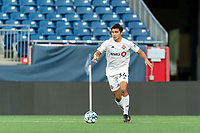 FOXBOROUGH, MA - JULY 23: Jon-Talen Maples #34 of Toronto FC II brings the ball forward during a game between Toronto FC II and New England Revolution II at Gillette Stadium on July 23, 2021 in Foxborough, Massachusetts.