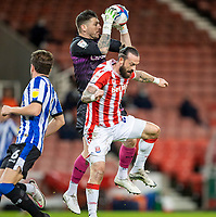 16th February 2021; Bet365 Stadium, Stoke, Staffordshire, England; English Football League Championship Football, Stoke City versus Sheffield Wednesday; Goalkeeper Keiren Westwood of Sheffield Wednesday collects the ball under pressure from Steven Fletcher of Stoke City