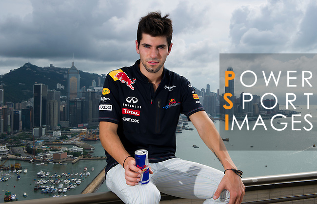 Red Bull Toro Rosso driver Jaime Alguersuari drinks a can of Red Bull on the roof of the Harbour Grand Hong Kong Hotel before participating in the Red Bull Dragon Run 2011 in Hong Kong, China.