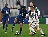 Football Soccer: UEFA Champions League -Round of 16 2nd leg Juventus vs FC Porto, Allianz Stadium. Turin, Italy, March 9, 2021.<br /> Porto's Jesus Corona (L) in action with Juventus' Arthur (R) during the Uefa Champions League football soccer match between Juventus and Porto at Allianz Stadium in Turin, on March 9, 2021.<br /> UPDATE IMAGES PRESS/Isabella Bonotto