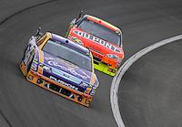 Feb 22, 2009; Fontana, CA, USA; NASCAR Sprint Cup Series driver Jamie McMurray leads Jeff Gordon during the Auto Club 500 at Auto Club Speedway. Mandatory Credit: Mark J. Rebilas-