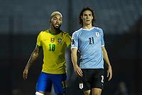 17th November 2020; Centenario Stadium, Montevideo, Uruguay; Qatar 2022 qualifiers; Uruguay versus Brazil; Edinson Cavani of Uruguay marked closely by Douglas Luiz of Brazil