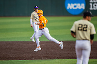 Tennessee Volunteers left fielder Evan Russell (4) jogs to third base after a home run against the Vanderbilt Commodores on Robert M. Lindsay Field at Lindsey Nelson Stadium on April 17, 2021, in Knoxville, Tennessee. (Danny Parker/Four Seam Images)