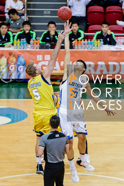The opening tip between Wu Cheuk Pan #30 of Eastern Long Lions and Hosford Ian Daniel #5 of Winling Basketball Club during the Hong Kong Basketball League game between Eastern Long Lions and Winling at Southorn Stadium on June 01, 2018 in Hong Kong. Photo by Yu Chun Christopher Wong / Power Sport Images