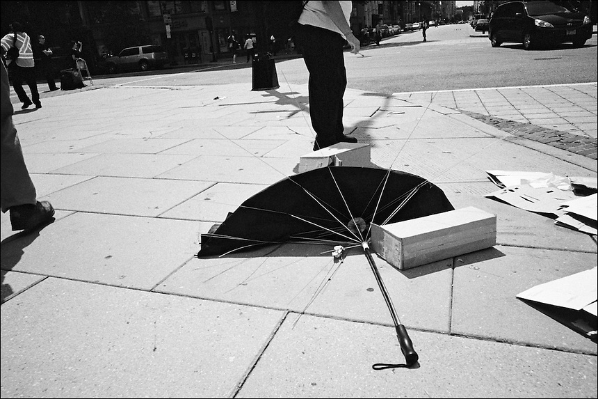 "The delicate balance of atanding and walking<br /> From ""Walking Downtown"" series. Washington, D.C., 2009"