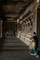 Ellora Caves Aurangabad in India..The famous Ellora caves are located in the lap of the Chamadari hills. These historical caves are regarded as world heritage and are situated 18 miles northwest of Aurangabad.  .A wonderful example of cave temple architecture, the world heritage Ellora caves own elaborate facades and intricately carved interiors. These carved structures on the inner walls of the caves reflect the three faiths of Hinduism, Buddhism and Jainism. These exotic caves were carved during 350 AD to 700 AD period. .Ellora caves are hewn out of basaltic rock of the Deccan trap, and are datable from circa 5th century A.D. to 11th century A.D. In all 34 caves were excavated here out of which Cave 1 to 12 are Buddhist, 13 to 29 are Brahmanical and 30 to 34 are Jaina. Cave 10 in Ajanta Caves contains the oldest Indian paintings of historical period, made around the 1st century BC.<br />