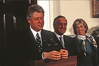 United States President Bill Clinton makes remarks as he participates in the annual presentation of a bowl of shamrocks honoring St. Patrick's Day with Taoiseach (Prime Minister) Albert Reynolds of Ireland in the Roosevelt Room of the White House in Washington, DC on March 17, 1993. During his remarks, President Clinton announced he was naming Jean Kennedy Smith as US Ambassador to Ireland.  From left to right: President Clinton, Prime Minister Reynolds, and Jean Kennedy Smith.<br /> Credit: Martin H. Simon / Pool via CNP/AdMedia