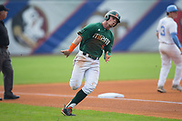 Carl Chester (9) of the Miami Hurricanes rounds third base on his way to scoring a run in the bottom of the first inning against the North Carolina Tar Heels in the second semifinal of the 2017 ACC Baseball Championship at Louisville Slugger Field on May 27, 2017 in Louisville, Kentucky.  The Tar Heels defeated the Hurricanes 12-4.  (Brian Westerholt/Four Seam Images)