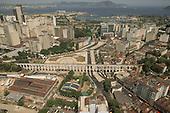 Rio de Janeiro, Brazil. aerial view of Praça Cardeal Câmara and the Arcos da Lapa viaduct with Guanabara Bay looking south west.