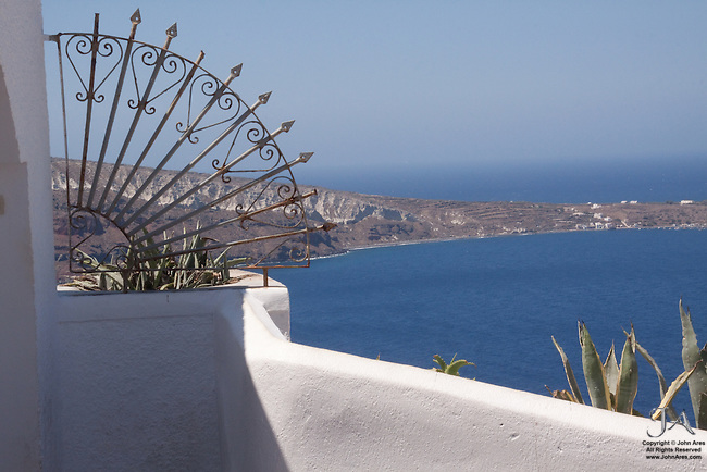 Inviting scene from Oia overlooking Thirassia