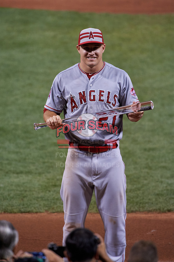 Los Angeles Angels Mike Trout shows off the game Most Valuable Player Award after the MLB All-Star Game on July 14, 2015 at Great American Ball Park in Cincinnati, Ohio.  (Mike Janes/Four Seam Images)