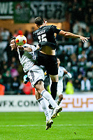 Thursday  03 October  2013  Pictured:( L-R )  Michu and Stephane Besle in a mid air tussle<br /> Re:UEFA Europa League, Swansea City FC vs FC St.Gallen,  at the Liberty Staduim Swansea